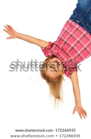 Gelukkig jaren oude meisje opknoping ondersteboven Stockfoto © Lopolo