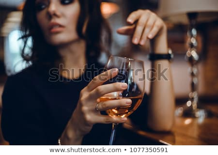 Attractive stylish woman drinking glass of red wine in vineyard Stock photo © boggy