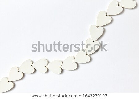 Handmade necklace made from paper hearts with soft shadows. Stock photo © artjazz