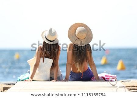 güneşlenme · plaj · renkli · güneş · şemsiyesi · kadın · oturma - stok fotoğraf © photography33