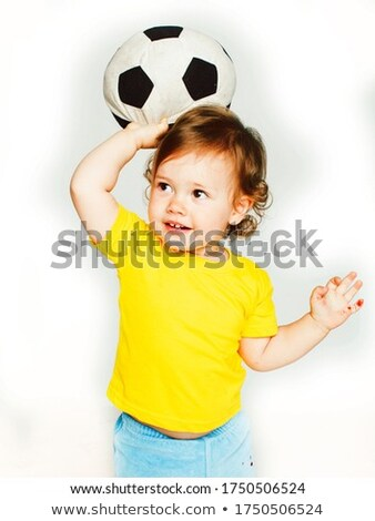 brunette little girl football player and ball smiling Stock photo © lunamarina