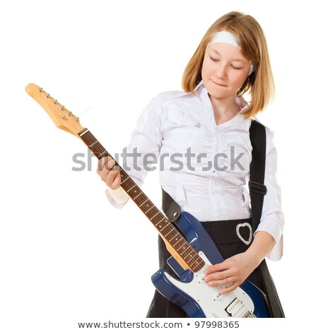 serious blond female playing electric guitar stock photo © sumners