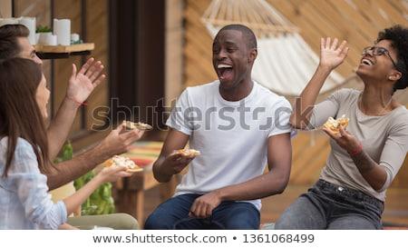 друзей сидят таблице улице Сток-фото © deandrobot