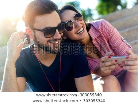 adolescente · mentiras · hierba · auriculares · joven · cara - foto stock © is2