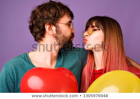 Boldog pár ibolya léggömbök csók buli Stock fotó © dolgachov