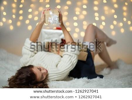 Dziewczyna leży puszysty koc christmas dar Zdjęcia stock © ElenaBatkova