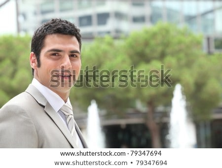 businessman outside an office building with fountains stock photo © photography33