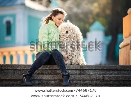 Beautiful young woman with dreadlocks siiting Stock photo © stepstock