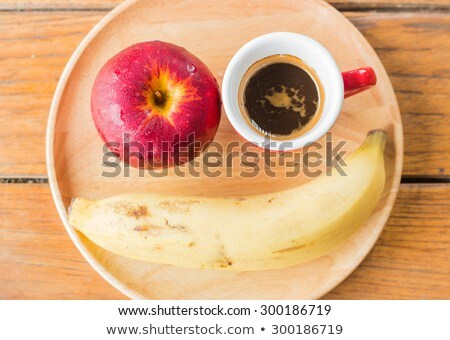 Easy meal with red apple, banana and coffee Stock photo © nalinratphi