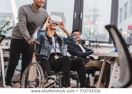 african businessman in a wheelchair disabilities and health ba stock photo © studiostoks