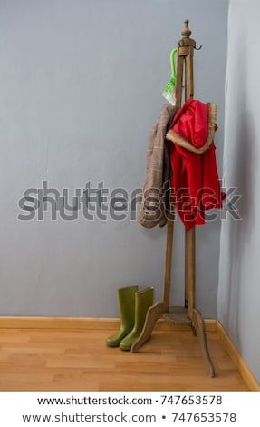 Warm clothes, umbrella, and wellington boots on wooden stand Stock photo © wavebreak_media