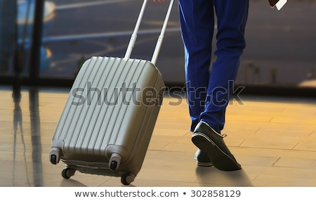 young casual man holding a suitcase stock photo © feedough