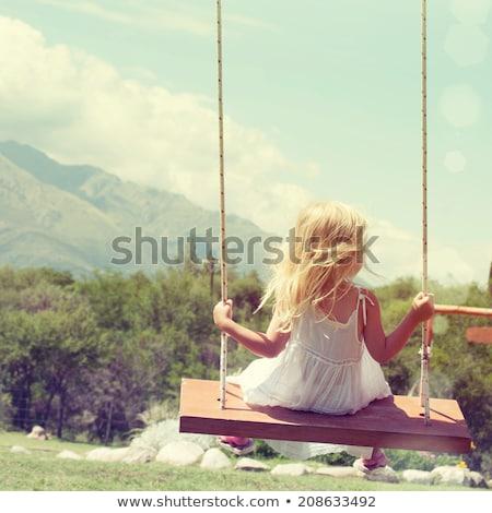 ストックフォト: 幸せ · 女の子 · 笑みを浮かべて · スイング · 草 · 学校