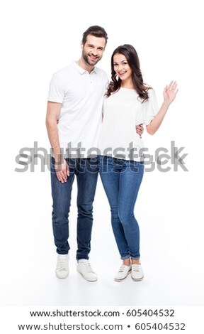 Front view of young Caucasian couple standing hand in hand at beach on a sunny day  Stock photo © wavebreak_media
