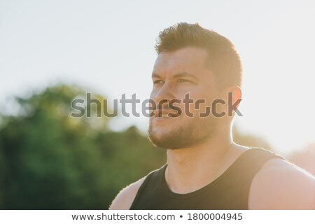 Sports man standing outdoors at the nature park location Stock photo © deandrobot