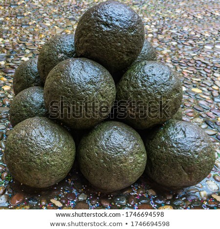 Stone cannon balls in the coutyard of Castle Estense, Ferrara Stock photo © boggy