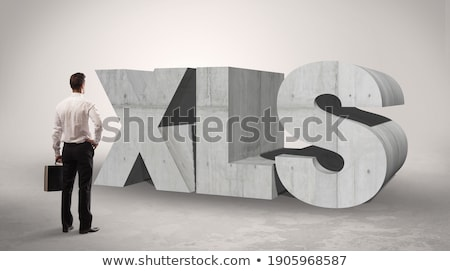 Rear view of a businessman standing in front of abbreviation Stock photo © ra2studio