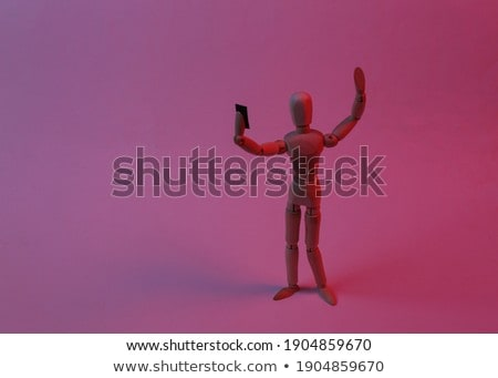 wooden puppet with a model red phohe Stock photo © compuinfoto