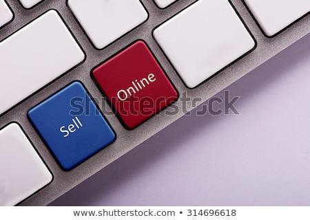 Online Sells on Red Keyboard Button. Stock photo © tashatuvango