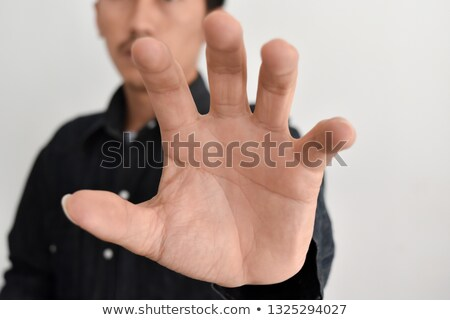 Young business man trying to grab something Stock photo © Nejron