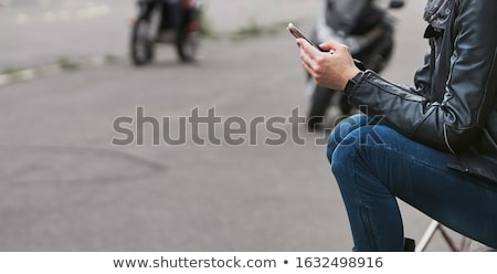 Stock photo: Young Woman Using Mobile Smart Phone Outdoors