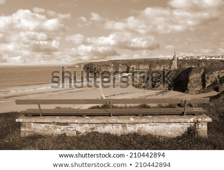 benches on a cliff edge with views of ballybunion in sepia stock photo © morrbyte