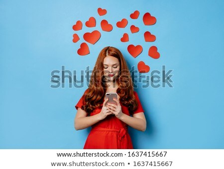 Young beautiful redhair female smiling Stock photo © dariazu