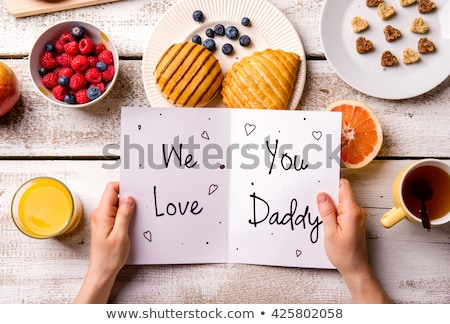 breakfast by fathers day greeting card on table stock photo © wavebreak_media