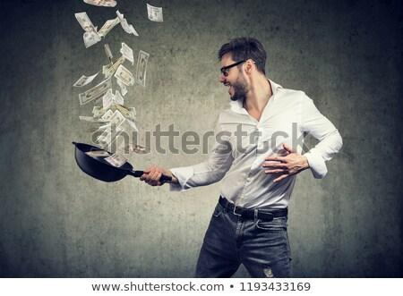 content man with frying pan full of dollar bills  Stock photo © ichiosea