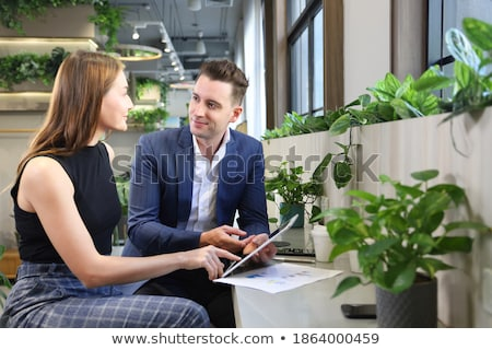man showing digital tablet to his friend stock photo © kzenon