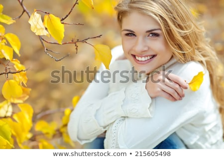 Pretty blond woman posing in an autumnal park Stock photo © konradbak