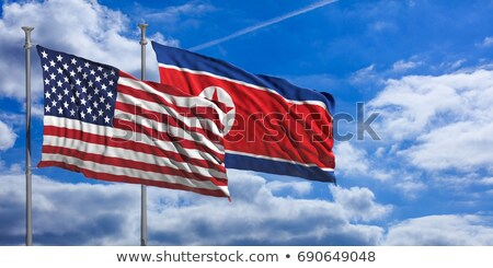 Stock photo: Two waving flags of United States and North Korea