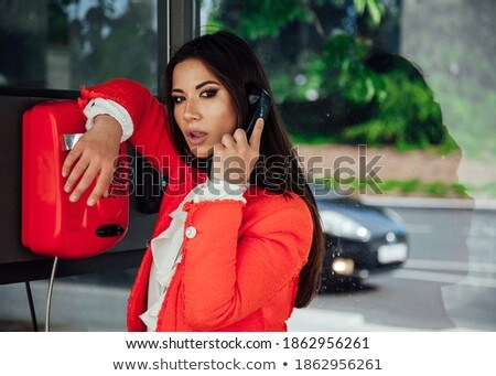Emotional busy brunette at street talking on call phone. Stock photo © studiolucky
