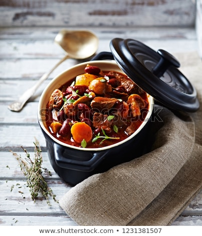 Traditional Hungarian goulash - stew of meat and vegetables with onions Stock photo © brebca