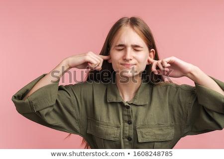Fotó elégedetlen kaukázusi nő csukott szemmel fülek Stock fotó © deandrobot