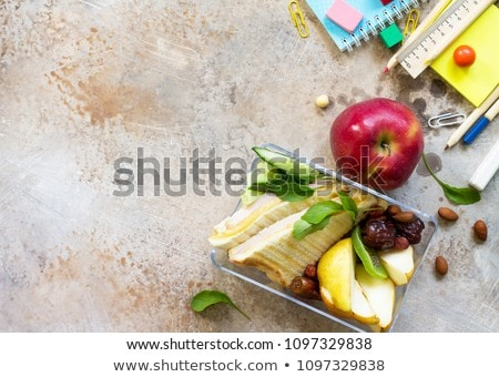 School lunch box and education stationery on stone table Stock photo © karandaev
