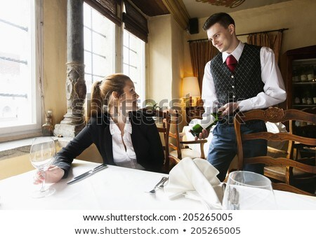 wine waiter showing glass of wine Stock photo © photography33