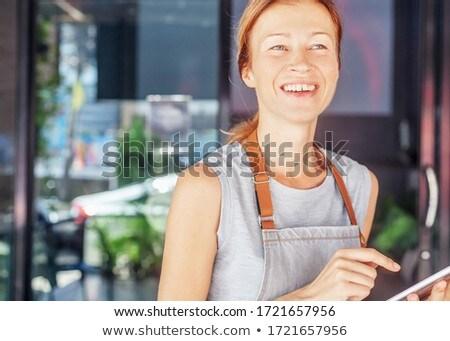 portrait of smiling waitress holding digital tablet at counter stock photo © wavebreak_media