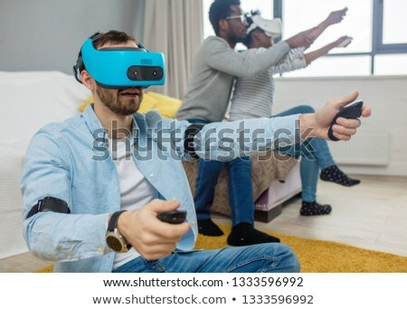 Young couple with having fun with virtual reality goggles headse Stock photo © DisobeyArt