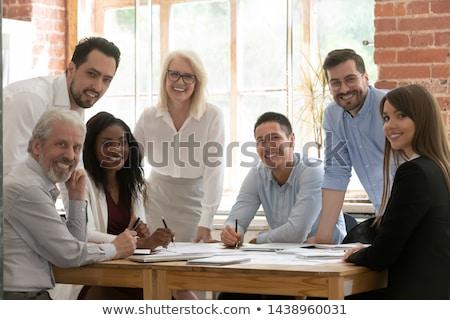 sokoldalú · emberek · beszélnek · együtt · munka · iroda · nő - stock fotó © deandrobot