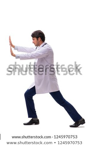 Young handsome doctor under pressure isolated on white Stock photo © Elnur