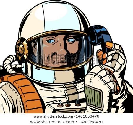 Ernstig astronaut praten retro telefoon Stockfoto © studiostoks