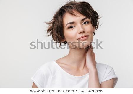 изображение оптимистичный Cute женщина улыбается глядя камеры Сток-фото © deandrobot