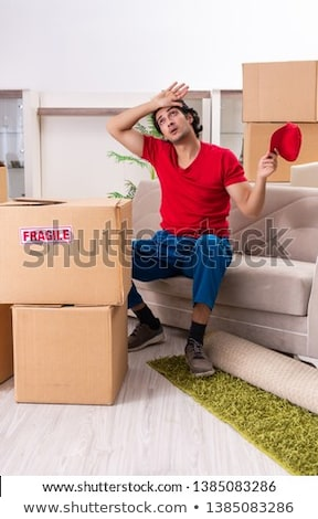 Young contractor with boxes working indoors  Stock photo © Elnur
