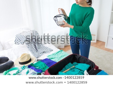 Travel and vacation concept, happiness young woman packing a lot Stock photo © Freedomz