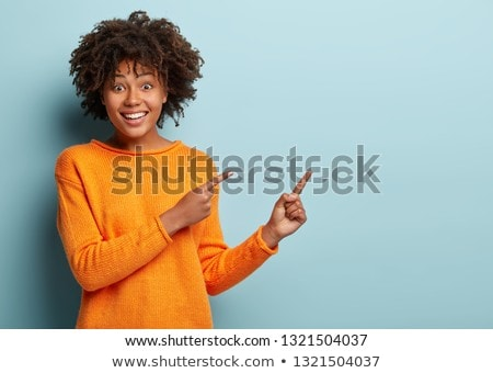 Woman giggling and pointing Stock photo © photography33