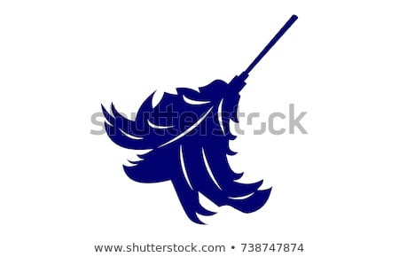 A maid with a feather duster stock photo © photography33