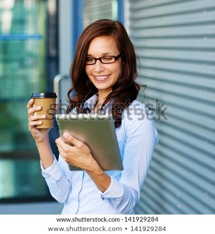 Csinos fiatal nő digitális tabletta irodaház fal Stock fotó © boggy