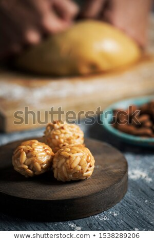 man preparing panellets, typical of Catalonia Stock photo © nito