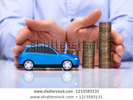 Man Protecting Blue Car And Stacked Coins Stock photo © AndreyPopov